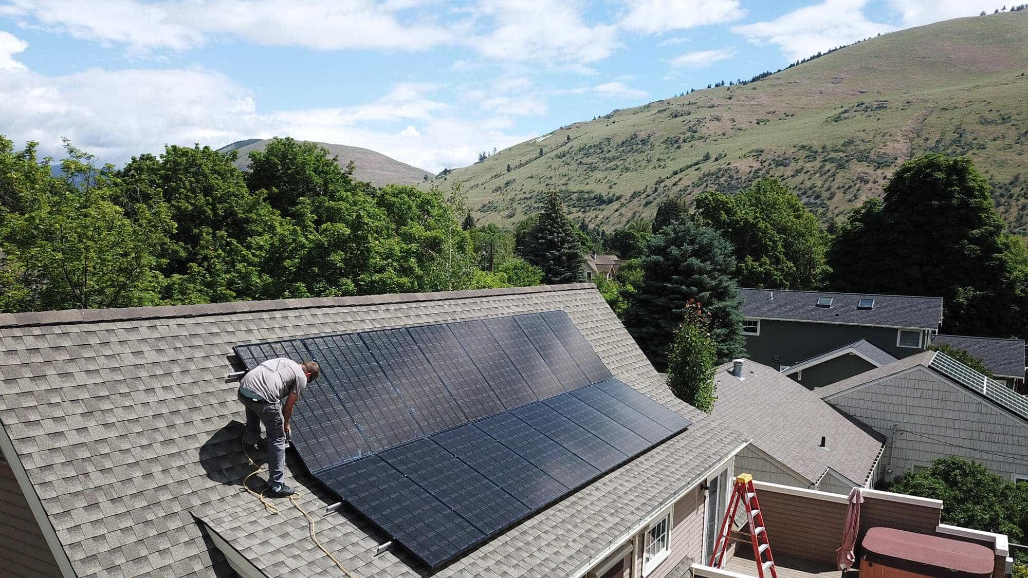 Solar panels being installed on roof
